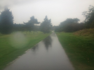 Rain on the road next to the footpath across Burghley Golf Course, but I was happy in my waterproof :)