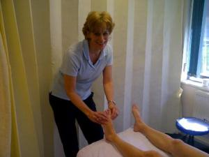 Karen in action, wiggling someones toes - try not to laugh! It wasn't that tickly...