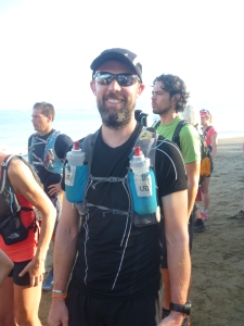 Chris on the beach before the start on Day 1, smiling!